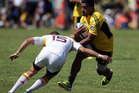 Rey LeeLo of the Hurricanes is tackled by Gareth Anscombe of the Chiefs during the Super Rugby trial match between the Hurricanes and the Chiefs. Photo / Getty Images.