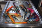 A colourful collection of fishing lures is standing by for action. Photo / Paul Rush