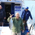 The writer proudly hoists a fine skipjack tuna aloft for the camera. Photo / Paul Rush