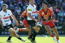  Shaun Johnson of the Warriors makes a break during the NRL trial match between the New Zealand Warriors and the Penrith Panthers. Photo / Getty Images.