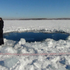 A circular hole in the ice of Chebarkul Lake where a meteor reportedly struck the lake near Chelyabinsk, about 1500 kilometers (930 miles) east of Moscow, Russia. Photo / AP
