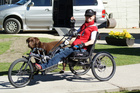 Catriona Williams, seen here with her dog Billy, will soon take part in an epic ride on her handcycle. Photo / Supplied