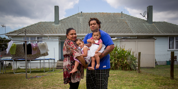 Ana and Tupou Malolo with their children, Kalolaine, 2, and Theresa, 1, at their rented home in Otara. Photo / Greg Bowker