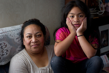 Manu Fotu, with her daughter Achorite, says she couldn't sleep at night after she lost her job.  Photo /  Sarah Ivey