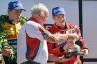 Nick Cassidy receives the New Zealand Grand Prix trophy from racing legend Chris Amon at Manfeild. Photo / Bruce Jenkins