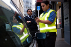 Parking warden Kelly on patrol with security supervisor Karamjeet Singh. Photo / Steven McNicholl
