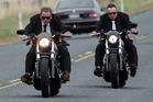 Lotto millionaire Trevor Cooper, left, rode a Harley Davidson Night Rod Special to his wedding, held at his $2 million Karaka home. Photo / Doug Sherring