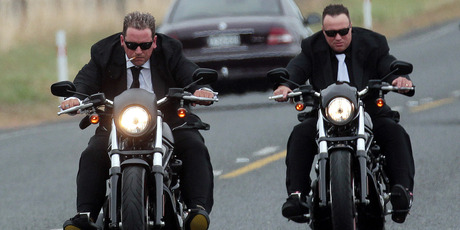 Lotto millionaire Trevor Cooper, left, rode a Harley Davidson Night Rod Special to his wedding, held at his $2 million Karaka home. Photo / Doug Sherring