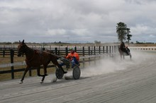 Eric Watson leaves his son Sam, 18, in his dust in their trotting duel. Photo / Supplied