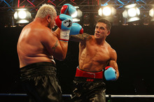 Sonny Bill Williams punches Francois Botha. Photo / Getty Images