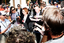 Julia Gillard and John Key answered questions in Queenstown yesterday after laying a wreath at the war memorial.  Photo / Getty Image