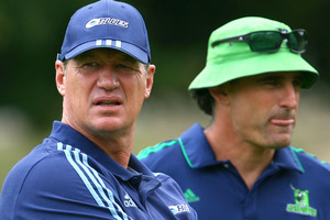 Blues' head Coach Sir John Kirwan (left) of the Blues and Highlanders assistant coach Scott McLeod watch tonight's match. Photo / Getty Images