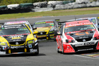 V8 SuperTourer drivers Greg Murphy and Scott McLaughlin do battle. Photo / Geoff Ridder