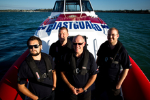 Coastguard crew members Elliot Brown, James Turner, Graeme Ogg and Stephen Maisey at work on board one of the Auckland Coastguard boats. Photo / NZH