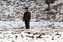A North Korean soldier patrols along the river bank of the North Korean town of Sinuiju. Photo / AP 