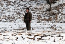 A North Korean soldier patrols along the river bank of the North Korean town of Sinuiju. Photo / AP