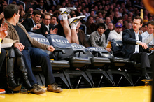 Los Angeles Lakers' Steve Blake falls over empty courtside chairs as he tries to save a ball from going out of bounds against the Phoenix Suns. Photo / AP