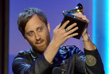 Dan Auerbach accepts the award for producer of the year non-classical during the pre-telecast at the 55th annual Grammy Awards. Photo / AP