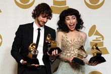 Gotye, left, and Kimbra pose backstage with the awards for best pop duo/group performance of the year and record of the year for 'Somebody That I Used to Know'. Photo / AP
