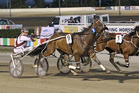 Anthony Butt drives Mah Sish (5, centre) to victory in the Hunter Cup two weeks ago. Photo / Harness Racing Victoria
