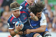 Luke Jones of the Rebels is tackled during the round one Super Rugby match between the Rebels and the Force. Photo / Getty Images. 