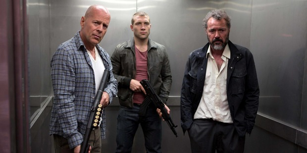Bruce Willis, left, Jai Courtney, and Sebastian Koch in A Good Day To Die Hard. Photo/AP