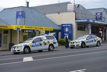 Police at the Mornington Night 'n Day after yesterday's armed robbery. Photo / Stephen Jaquiery
