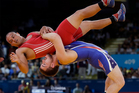 The NZOC is satisfied all major New Zealand Olympic sports have secured their spots on the core Games programme for 2020 as wrestling battles to maintain its status. Photo / AP