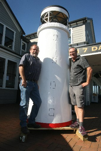 RESTORED: Director John Keen and committee member Murray Callister size up the lighthouse model.