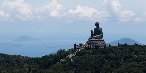 Tian Tan Buddha, a large bronze statue of a Buddha Amoghasiddhi, is seen on Lantau Island, a popular tourist spot in Hong Kong. Photo / AP