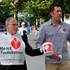 Hoani Macdonald and Mayor Len Brown walk down Queen St collecting for the Heart Foundation. Photo / Herald On Sunday