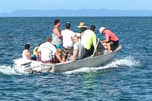 The smallest child is the only one of the nine people in the dinghy wearing a lifejacket. Photo / Gary Carruthers