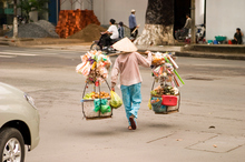 A Ho Chi Minh street vendor laden with wares. Photo / Thinkstock