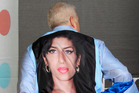 Mitchell Winehouse displays his shirt with an image of his deceased daughter Amy Winehouse. Photo / AP