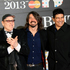 Pat Smear, Dave Grohl and Rick Nielsen seen arriving at the BRIT Awards 2013. Photo / AP