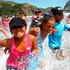 Year 6 pupils from Ranui Primary School make a splash at Piha Beach. Photo / Chris Gorman