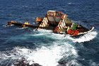 What is left of the stricken ship Rena on the Astrolabe Reef off the coast of Tauranga. Photo / BOP