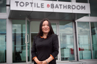 Lanfang Zhang says she is not prepared to buy $500,000 of bathroom stock for her business. Photo / Natalie Slade