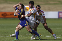 The Chiefs' Ross Filipo (centre) gave Shaun Treeby (lef