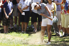 Kiwi women's golf star Lydia Ko blasts out of the rough on the first hole at Royal Canberra. Photo / Getty Images