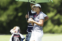 Lydia Ko watches the group ahead on the 5th hole.