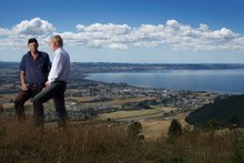 Federated Farmers provincial president Neil Heather and MP Todd McClay, on the heights of Mr Heather's farm overlooking Lake Rotorua, are happy progress has been made. Photo / Alan Gibson.