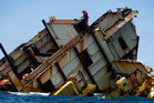 Insurers and owners want to turn the Rena wreck into a dive site, but most locals want it gone. Photo / Alan Gibson