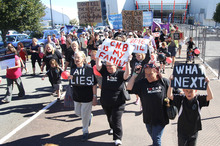 Teachers and students of Central New Brighton School protest school closures and merges at CBS Canterbury Arena. Photo / APN