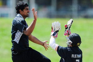 Ish Sodhi celebrates taking a wicket with Cameron Fletcher of New Zealand. Photo / Getty Images