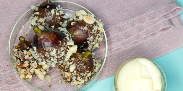 Chocolate dipped figs with macadamia nuts and cream. Photo / Michael Craig