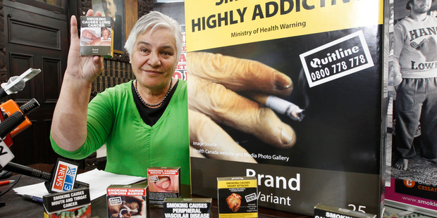 Loading Associate Health Minister Tariana Turia, with examples of the proposed packaging, is confident any legal challenges will be defeated, saying: 'They won't win.' Photo / Mark Mitchell