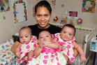 Niah Evile Pule with her 6-month-old triplets Agaalofa, Agamalu and Agalelei. Photo/ Martin Hunter