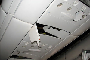 Example of damage to the fittings above passenger seats in the rear section of the Qantas Airbus 330. Photo / Supplied by ATSB