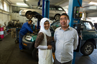 Laila Basiri with her grandfather Qurban Ali and father Shahwali at the family auto mechanic business. Photo / Michael Craig